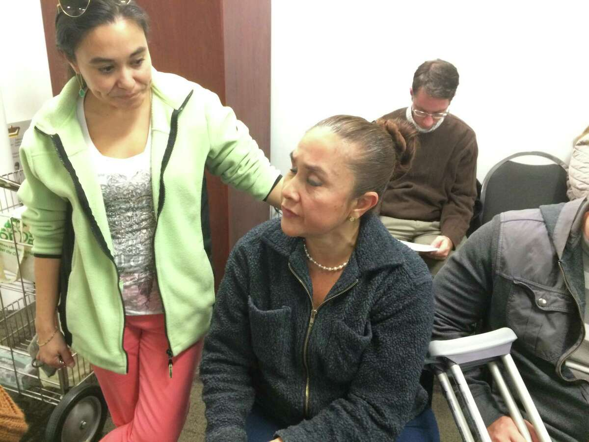 Maria Mercedes Vargas (seated), who is the operator of a home-based massage business in The Woodlands, is shown during a meeting of the Development Standards Design Committee on Jan. 17, 2018. Vargas and one of her sons appeared at the Dec. 11, 2019, meeting of the DSC and issued public apologies for lying and fabricating claims of racist abuse from neighbors who opposed the home-business for several reasons.