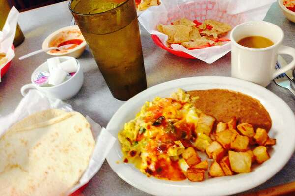 Migas offers a comforting hug of a breakfast of carbs, eggs and heat that somehow seems to help with a hangover.