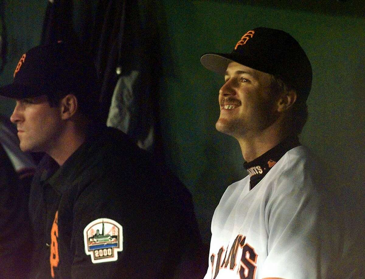 San Francisco Giants Jeff Kent, right, smiles as manager Dusty Baker jokes with him in the dugout in the sixth inning Tuesday, May 20, 1997 in San Francisco. Kent's grand slam in the first inning helped beat the Colorado Rockies 6-3. (AP Photo/Susan Ragan)