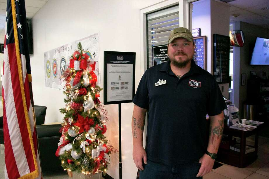John Royalty, center operations supervisor for north Houston and retired military, stands at the entrance of the IAH USO. Photo: Savannah Mehrtens/Staff Photo / Savannah Mehrtens/Staff Photo