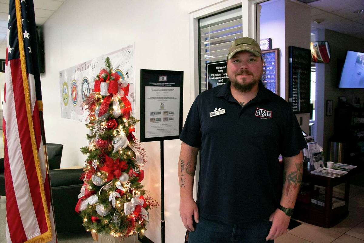 John Royalty, center operations supervisor for north Houston and retired military, stands at the entrance of the IAH USO.