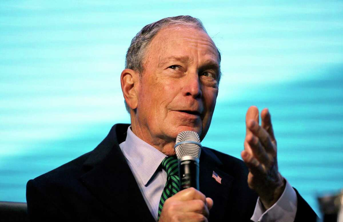 FILE - In this Dec. 11, 2019 file photo, Democratic presidential candidate and former New York City Mayor Michael Bloomberg gestures while taking part at the American Geophysical Union fall meeting in San Francisco. A top California Democratic Party official is leaving his post to run Bloomberg's presidential operation in the state. Bloomberg's campaign announced Tuesday, Dec. 24, that Chris Masami Myers will lead the billionaire businessman's campaign in California starting next month. (AP Photo/Eric Risberg, File)