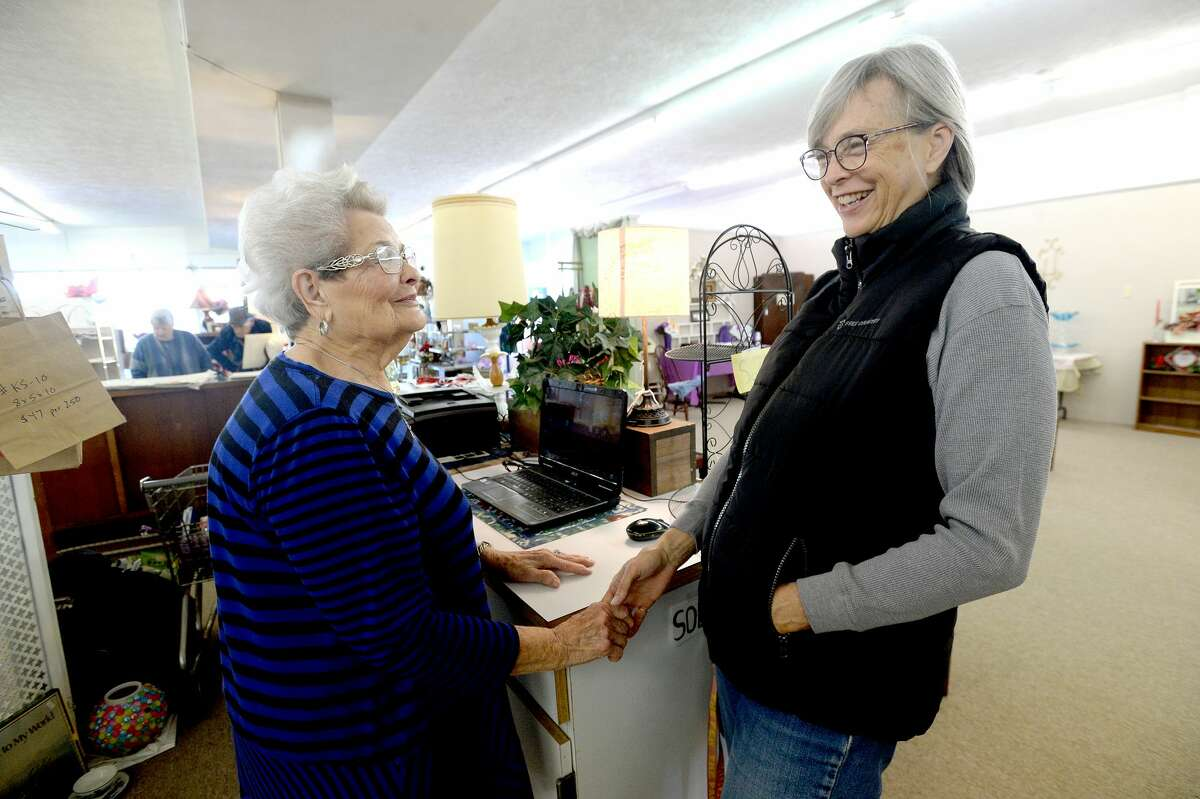 Holland House owner Dollye Roberts (left) jokes jokes with LaRue Rougeau, who stopped to visit and share in the New Year's Eve day celebration of Roberts' retirement and the long-time Boston Avenue business' last day Tuesday. At 93, Roberts has been an icon of Nederland and its downtown businesses since she and her husband moved to the city in 1946. Photo taken Tuesday, December 31, 2019 Kim Brent/The Enterprise