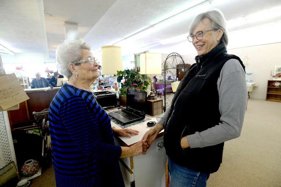 Holland House owner Dollye Roberts (left) jokes jokes with LaRue Rougeau, who stopped to visit and share in the New Year's Eve day celebration of Roberts' retirement and the long-time Boston Avenue business' last day Tuesday. At 93, Roberts has been an icon of Nederland and its downtown businesses since she and her husband moved to the city in 1946. Photo taken Tuesday, December 31, 2019 Kim Brent/The Enterprise Photo: Kim Brent/The Enterprise