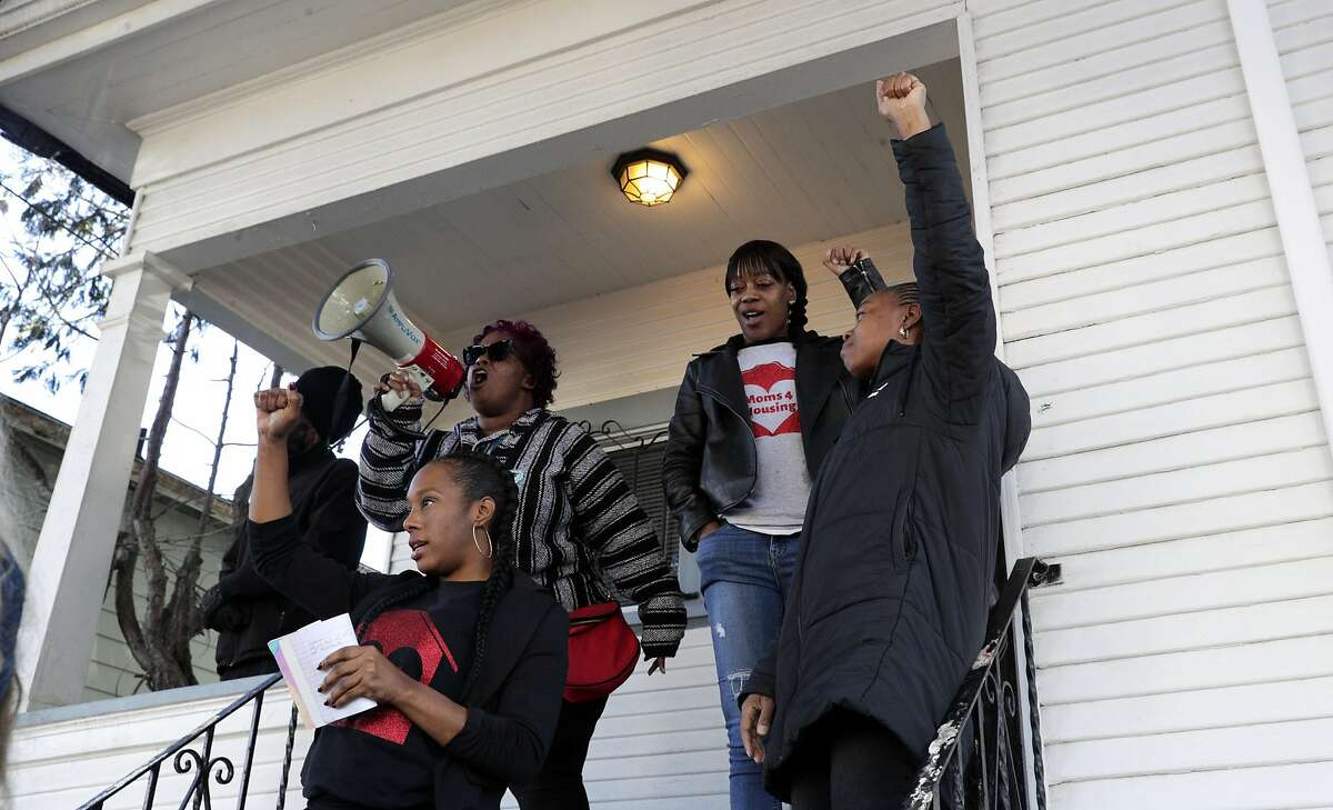 L-R, Dominique Walker, Sharena Thomas, Misty Cross and Tolani King, the four moms living at a home on Magnolia Street in Oakland, Calif., address their supporters after a judge ordered a continuance to a case involving several mothers with children living in an empty home owned by Wedgewood Properties, a Redondo Beach company, on Monday, December 30, 2019. Dominique Walker, a mother to a 1-year-old, moved into a vacant home on Nov. 18 with another Oakland mother, and earlier this month, the corporation that owns the home, delivered an eviction notice. The women - who are homeless - first took over the residence to get shelter and to bring attention to how vacant properties in Oakland are contributing to the homeless crisis.