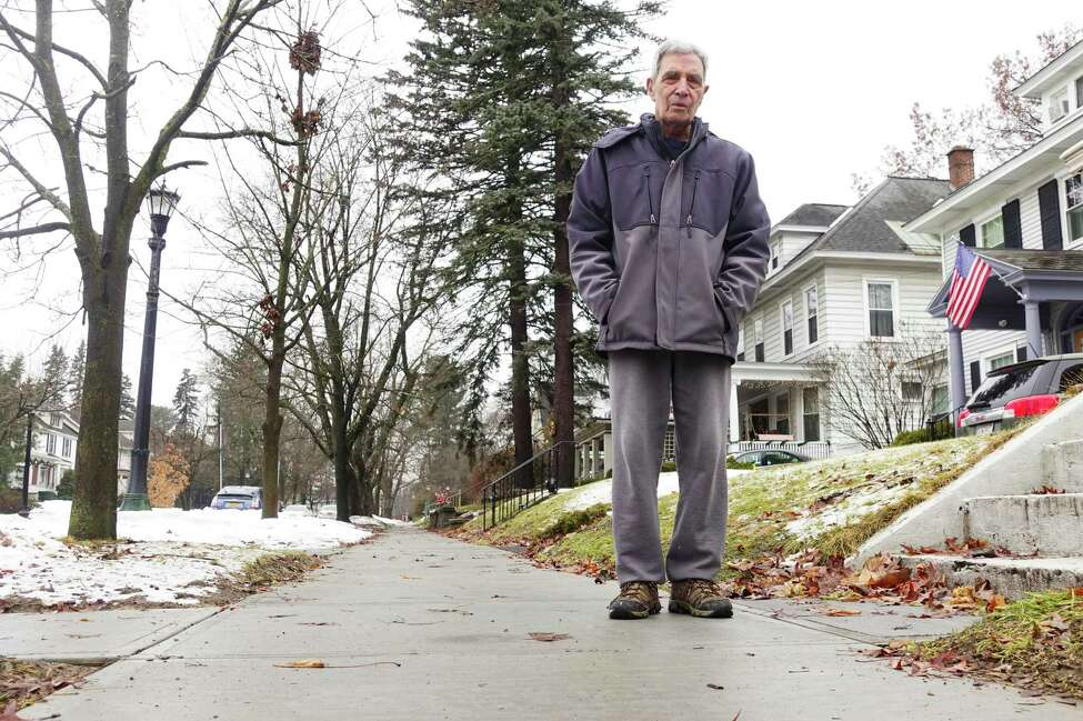 Budd Mazurek stands on the new sidewalks outside his and his neighbor's homes on Ardsley Road on Tuesday, Dec. 31, 2019, in Schenectady, N.Y. (Paul Buckowski/Times Union)