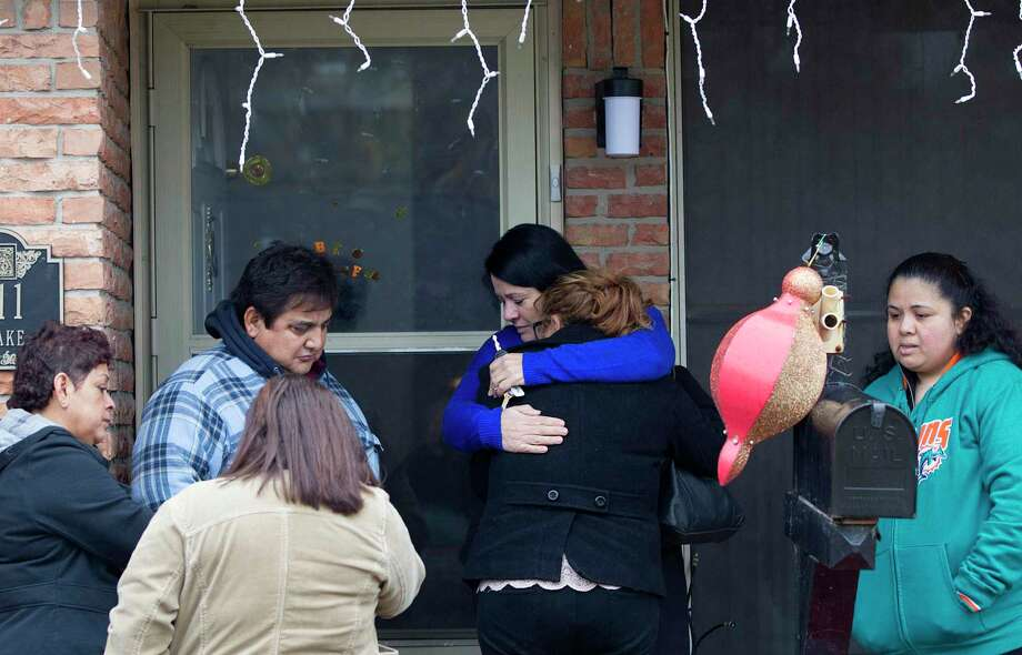 In this 2015 file photo, a family friend holds onto 16-year-old Keyla Rivera, the daughter of Javier Suarez Rivera, after her father Javier was struck and killed by a suspected stray bullet from celebratory gunfire on New Year's Day in southeast Houston. Crime Stoppers of Houston is offering up to $5,000 to residents who report illegal celebratory gunfire on New Year's Day that results in a prosecution. Photo: Johnny Hanson, Staff / Houston Chronicle / © 2015  Houston Chronicle
