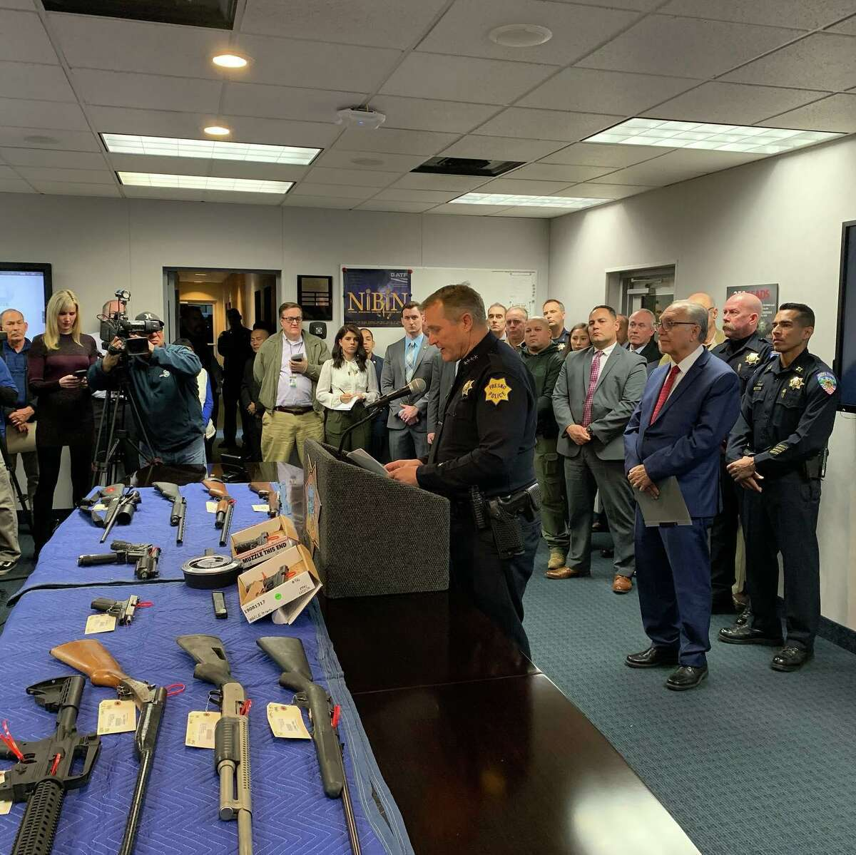 During a press conference on Dec. 31, 2019, the Fresno Police Department displayed a cache of rifles and handguns they had confiscated while six people in connection with a Nov. 17, 2019 mass shooting on the patio of a Fresno home which left four people dead and 10 more wounded as they watched a football game. Chief Andy Hall addresses the media.