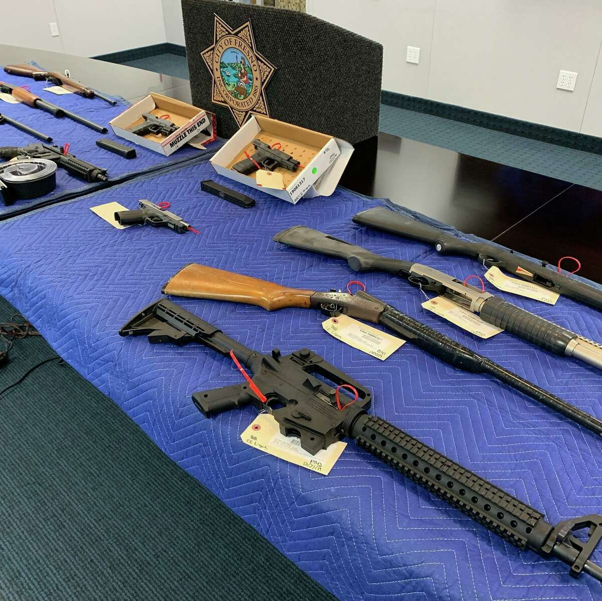 Fresno police displayed a cache of rifles and handguns confiscated while six people in connection with a Nov. 17, 2019 mass shooting on the patio of a Fresno home which left four people dead and 10 more wounded as they watched a football game.