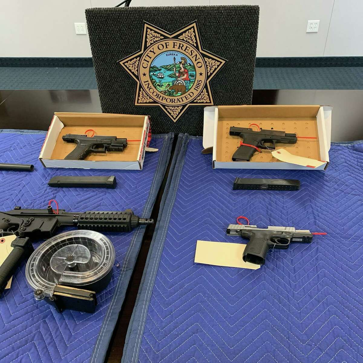 During a press conference on Dec. 31, 2019, the Fresno Police Department displayed a cache of rifles and handguns they had confiscated while six people in connection with a Nov. 17, 2019 mass shooting on the patio of a Fresno home which left four people dead and 10 more wounded as they watched a football game.