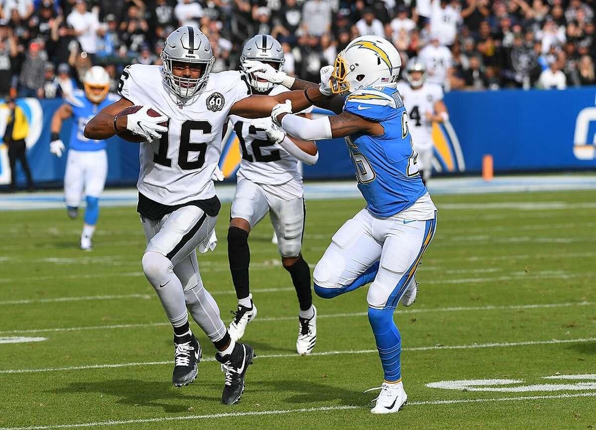 CARSON, CA - DECEMBER 22: Wide receiver Tyrell Williams #16 of the Oakland Raiders rubs for a first down before he is pushed out of bounds by cornerback Casey Hayward #26 of the Los Angeles Chargers in the first quarter of the game at Dignity Health Sports Park on December 22, 2019 in Carson, California. (Photo by Jayne Kamin-Oncea/Getty Images)