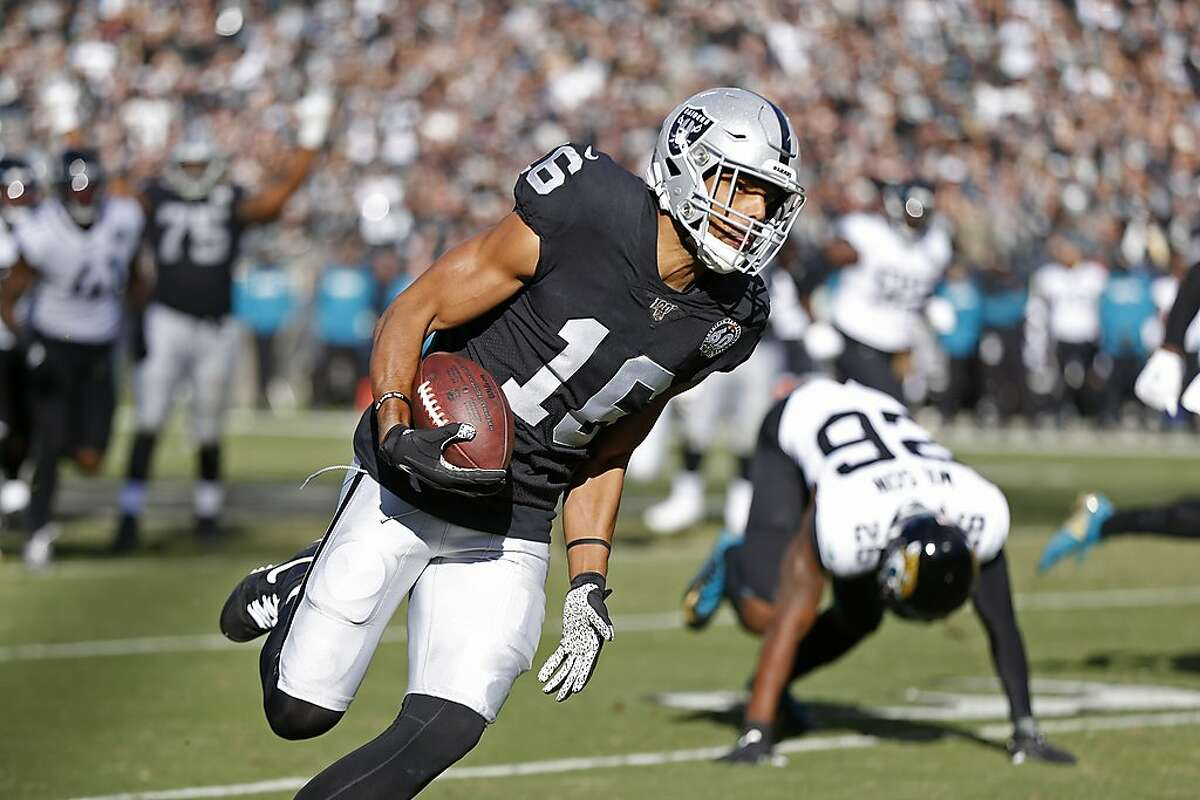 Oakland Raiders wide receiver Tyrell Williams runs with the ball for a touchdown past Jacksonville Jaguars free safety Jarrod Wilson (26) during the first half of an NFL football game in Oakland, Calif., Sunday, Dec. 15, 2019. (AP Photo/D. Ross Cameron)