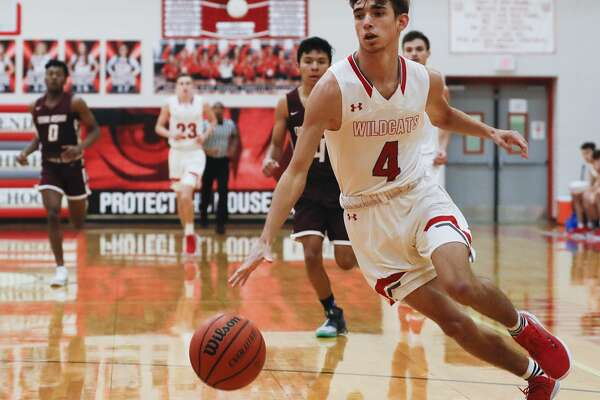 Splendora shooting guard Scott Norwood (4) breaks toward the basket during the first quarter of a non-district high school basketball game at Splendora High School, Tuesday, Dec. 31, 2019, in Splendora.