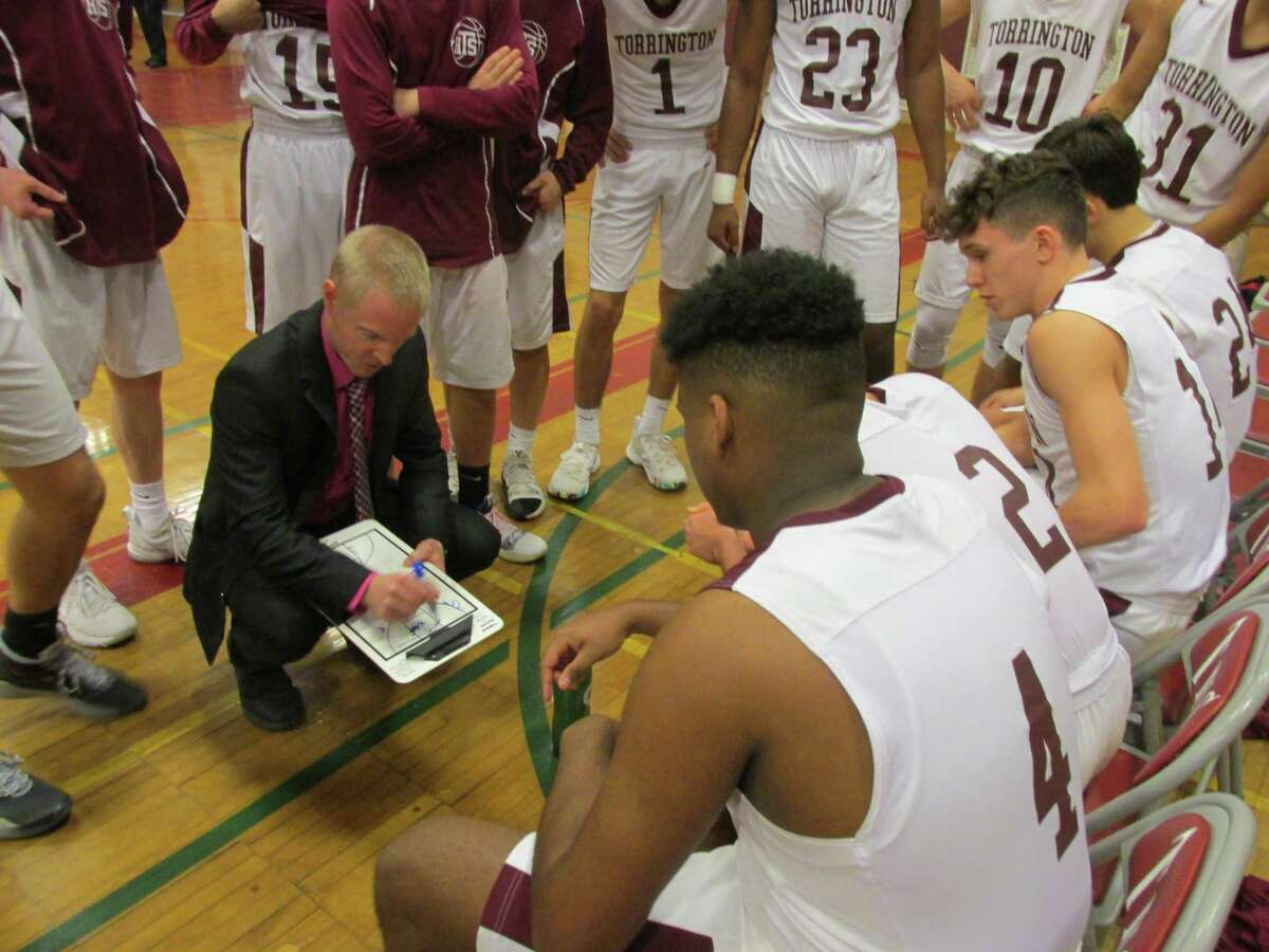 Torrington coach Eric Gamari plots out an offense that relies on all five players working together in the Red Raiders' win over Seymour Tuesday afternoon at Torrington High School.