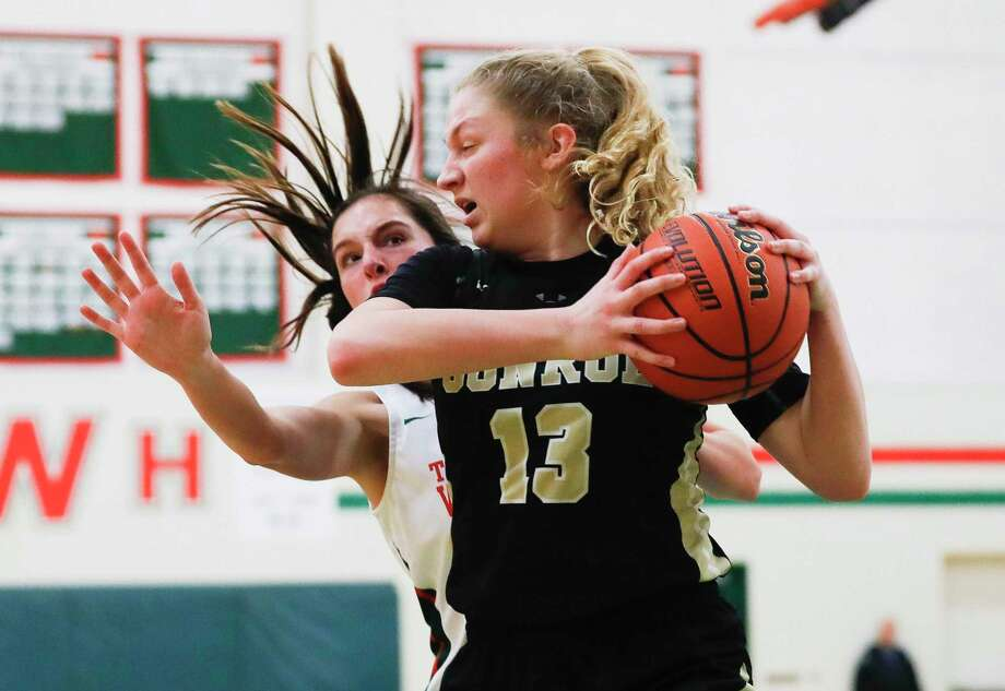 Conroe forward Sarah Sowell (13) grabs a rebound in front of The Woodlands forward Anna Orr (15) during the third quarter of a District 15-6A high school basketball game at The Woodlands High School, Tuesday, Dec. 31, 2019, in The Woodlands. Photo: Jason Fochtman, Houston Chronicle / Staff Photographer / Houston Chronicle