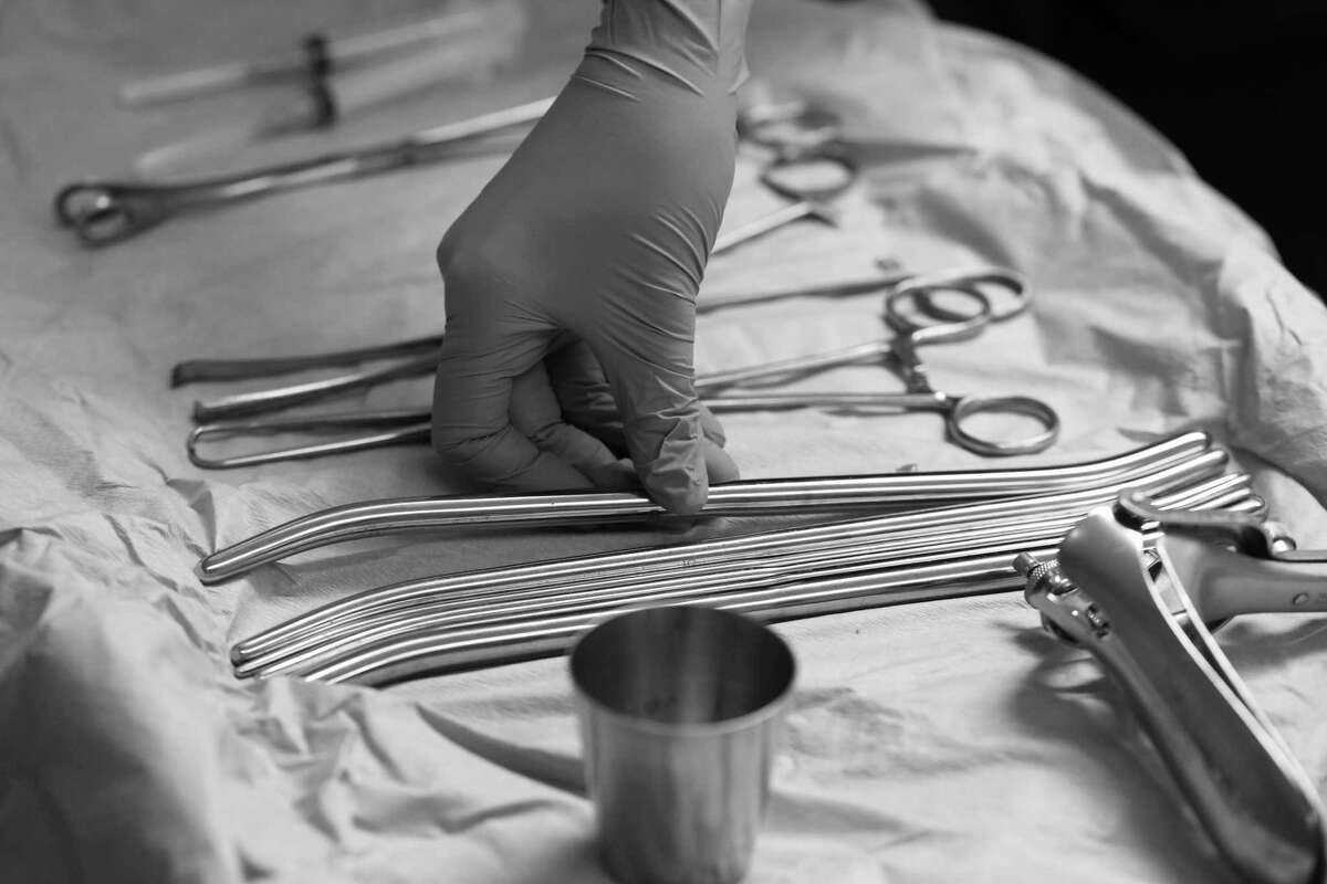 Dr. Jessica Rubino, an abortion provider, adjusts instruments used for abortion procedures during the reopening of Whole Woman's Health's flagship abortion clinic in Austin, Texas on May 11, 2017. It was one of some 20 clinics that closed in the wake of House Bill 2.