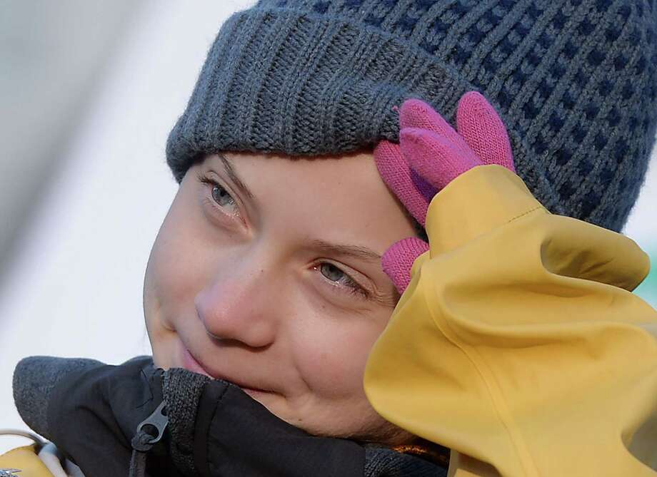 Swedish climate activist Greta Thunberg looks on as she takes part in the Friday for Future strike on climate emergency, in Turin, on December 13, 2019. - Greta Thunberg, the teenager who became the voice of a generation facing the climate change emergency, was named Time magazine's 2019 Person of the Year. Unknown to the world when she launched a solo strike against global warming in mid-2018, the 16-year-old has since inspired millions in a worldwide movement that saw her tipped as a Nobel laureate. (Photo by Filippo MONTEFORTE / AFP) (Photo by FILIPPO MONTEFORTE/AFP via Getty Images) Photo: FILIPPO MONTEFORTE, Contributor / AFP Via Getty Images / AFP or licensors