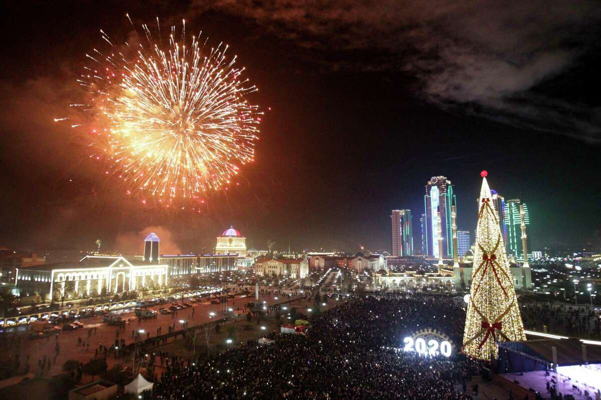 Fireworks explode over a Christmas tree and skyscrapers during New Year's celebrations in Grozny, Russia, Wednesday, Jan. 1, 2020. Russians began the world's longest continuous New Year's Eve with fireworks and a message from President Vladimir Putin urging them to work together in the coming year.
