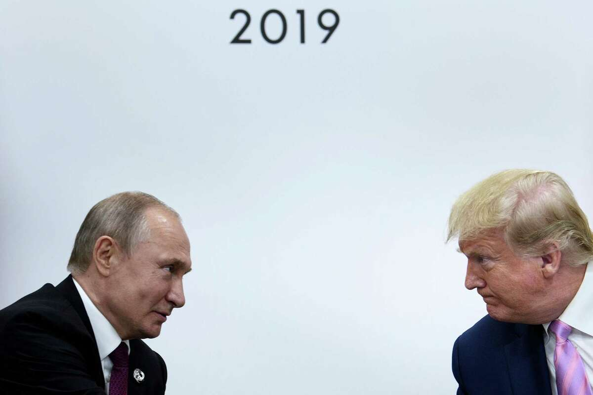 """FILE PHOTO - In this file photo taken on June 28, 2019 US President Donald Trump (R) attends a meeting with Russia's President Vladimir Putin during the G20 summit in Osaka, Japan. - President Donald Trump said on December 31, 2019 that """"great & important coordination"""" between the US and Russia had helped thwart an attack in Saint Petersburg. """"President Putin of Russia called to thank me and the U.S. for informing them of a planned terrorist attack in the very beautiful city of Saint Petersburg,"""" Trump tweeted. (Photo by Brendan Smialowski / AFP) (Photo by BRENDAN SMIALOWSKI/AFP via Getty Images)"""
