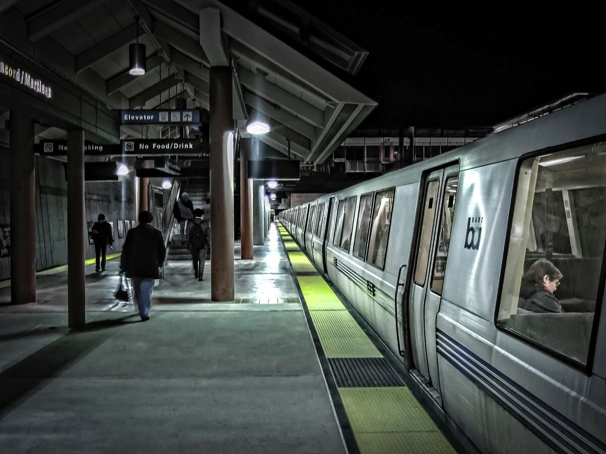 File photo of commuters and train riders at the Concord/Martinez BART station at nighttime.
