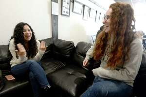 Friends Theresa Manriquez (left) and Laura Binagia react as they share their goals for the new year, which includes celebrating 20 years of friendship in 2020. The Nederland natives spend Tuesday afternoon catching up at The Avenue Coffee & Cafe while Binagia was home for the holidays after having gotten a job in Fort Worth post-graduation, and where Manriquez is currently livnig while job searching post-graduation.   Photo taken Tuesday, December 31, 2019 Kim Brent/The Enterprise