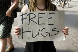 HugTrain is offering free hugs at the Golden Gate Bridge just before midnight this New Year's Eve.