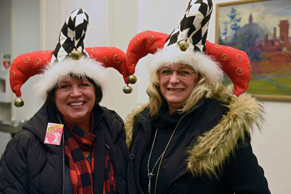 Christine Ellis, left, and Deb Scheffel, both of Saratoga Springs, sport their festive hats at the First Night celebration in the Saratoga Springs City Center on Tuesday, Dec. 31, 2019 in Saratoga Springs, N.Y. (Lori Van Buren/Times Union)