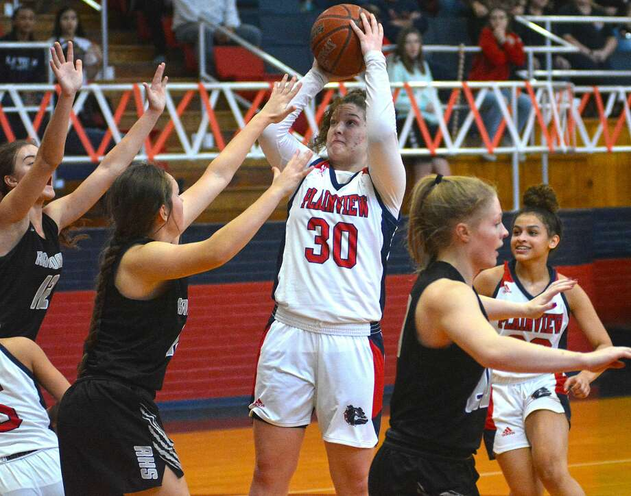Plainview's Kylie Bennett puts up the shot over a pair of Canyon Randall defenders during their District 3-5A girls basketball game on Tuesday afternoon in the Dog House. Photo: Nathan Giese/Planview Herald