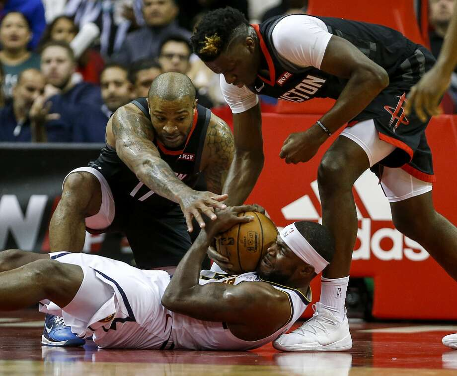 P.J. Tucker and Clint Capela are both cleared for Tuesday's game in Memphis. Photo: Jon Shapley/Staff Photographer