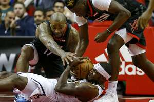 Houston Rockets forward PJ Tucker (17), center Clint Capela (15) and Denver Nuggets forward Paul Millsap (4) struggle over the ball during the second quarter of an NBA game at the Toyota Center on Tuesday, Dec. 31, 2019, in Houston.