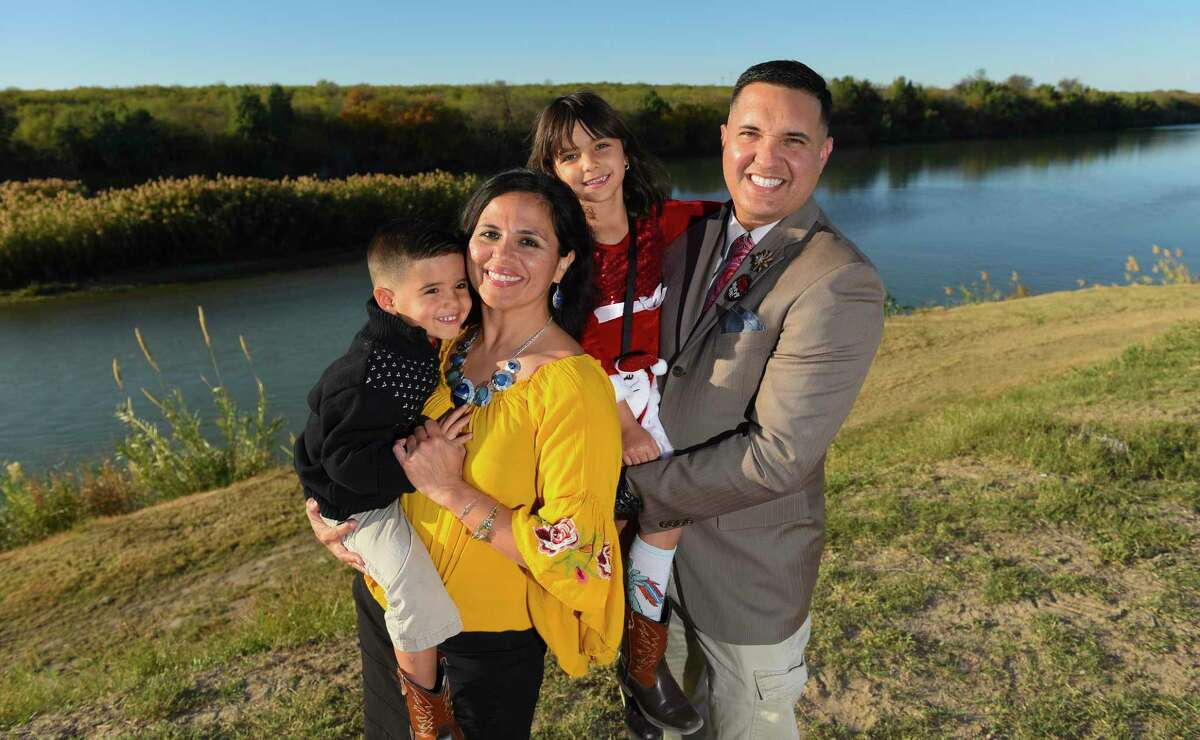 Laredoan of the Year Tricia Cortez is pictured with her family including Max Lopez, Marley Lopez and Joey Lopez Jr., along the riverbanks of the Rio Grande on Monday.