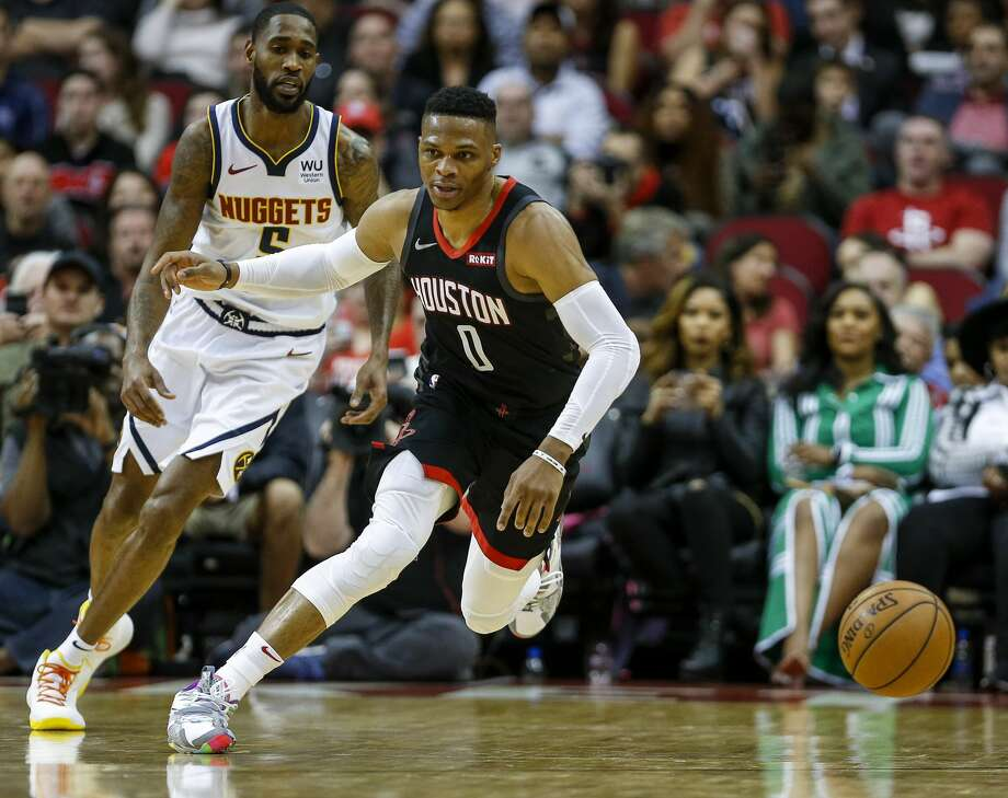 Houston Rockets guard Russell Westbrook (0) goes after a loose ball while guarded by Denver Nuggets guard Will Barton (5) during the fourth quarter of an NBA game at the Toyota Center on Tuesday, Dec. 31, 2019, in Houston. Photo: Jon Shapley/Staff Photographer