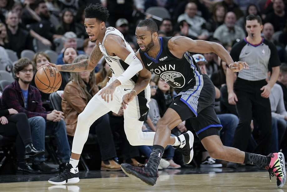 San Antonio Spurs guard Dejounte Murray, left, takes possession of the ball from Golden State Warriors guard Alec Burks during the second half of an NBA basketball game, Tuesday, Dec. 31, 2019, in San Antonio. San Antonio won 117-113 in overtime. (AP Photo/Darren Abate) Photo: Darren Abate, Associated Press