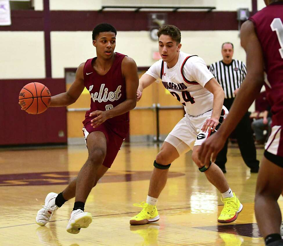 Watervliet's J.J. Chestnut drives to the hoop against Guilderland's Christian Halayko during a basketball game on Tuesday, Dec. 31, 2019 in Colonie, N.Y. (Lori Van Buren/Times Union)