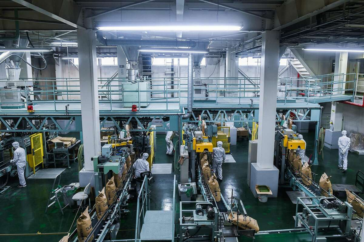 Packing lines at a sugar beet processing facility in Shari Gun, on Hokkaido, Japan, Nov. 5, 2019. With a declining population and workers in short supply, Japan has fully embraced robots, but getting them to work to 'the standard of humans' is often a challenge. (Noriko Hayashi/The New York Times)