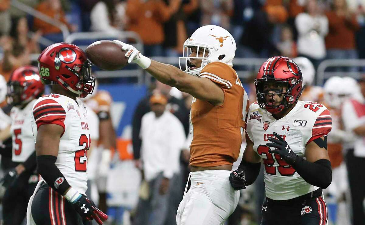 Texas Longhorns' Collin Johnson (09) gestures for a first down after his catch midfield against Utah Utes' Terrell Burgess (26) during the first half at the 2019 Valero Alamobowl at the Alamodome on Tuesday, Dec. 31, 2019.