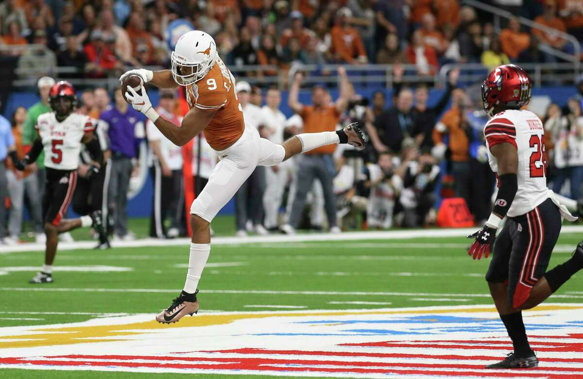 Texas Longhorns' Collin Johnson (09) makes a catch midfield against Utah Utes' Terrell Burgess (26) during the first half at the 2019 Valero Alamobowl at the Alamodome on Tuesday, Dec. 31, 2019.