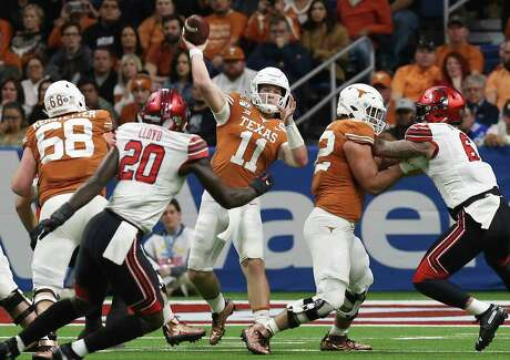 Texas Longhorns' quarterback Sam Ehlinger (11) attempts a pass against the Utah Utes in the first half at the 2019 Valero Alamobowl at the Alamodome on Tuesday, Dec. 31, 2019.