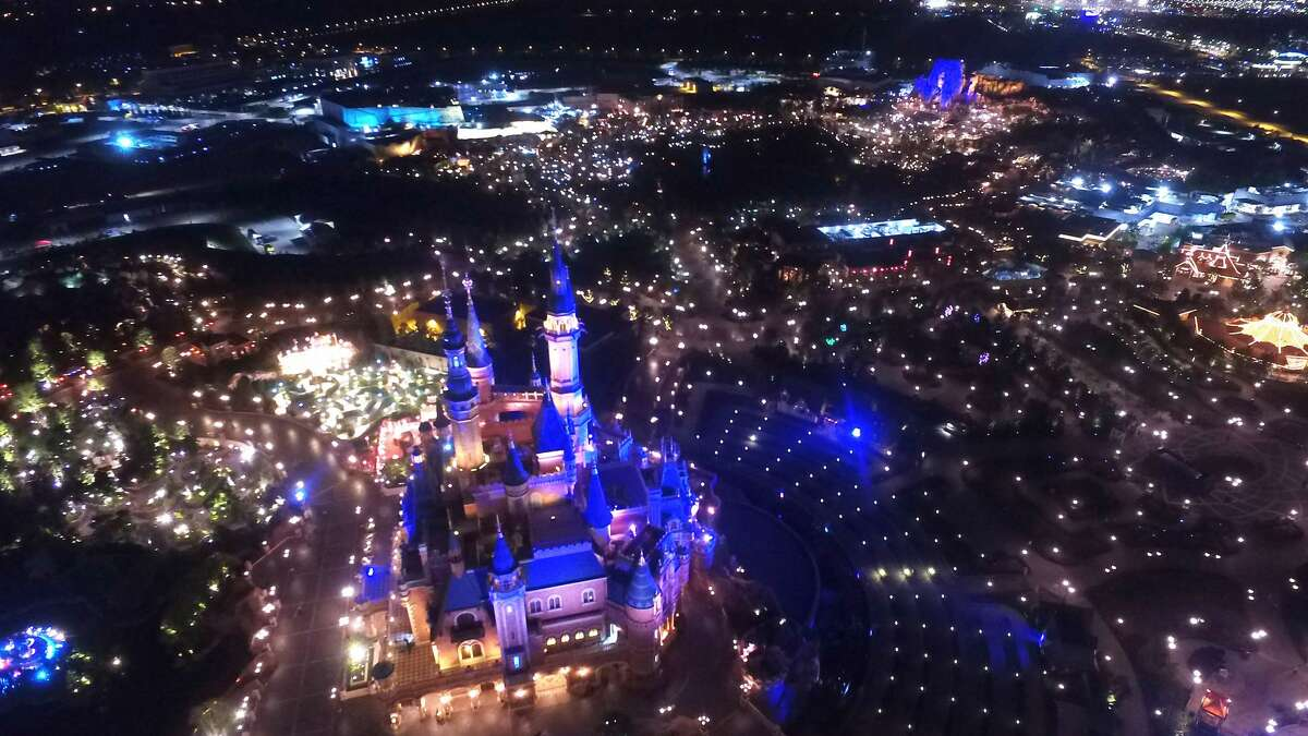 Aerial drone photo shows the night view of Shanghai Disney Resort.
