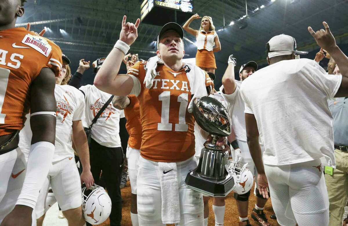 Texas Longhorns' quarterback Sam Ehlinger (11) joins the team in the school song after defeating the Utah Utes in the 2019 Valero Alamo Bowl at the Alamodome on Tuesday, Dec. 31, 2019. The Longhorns defeated the Utes, 38-10, to win the 2019 Valero Alamo Bowl. Ehlinger received the offensive player of the game trophy.