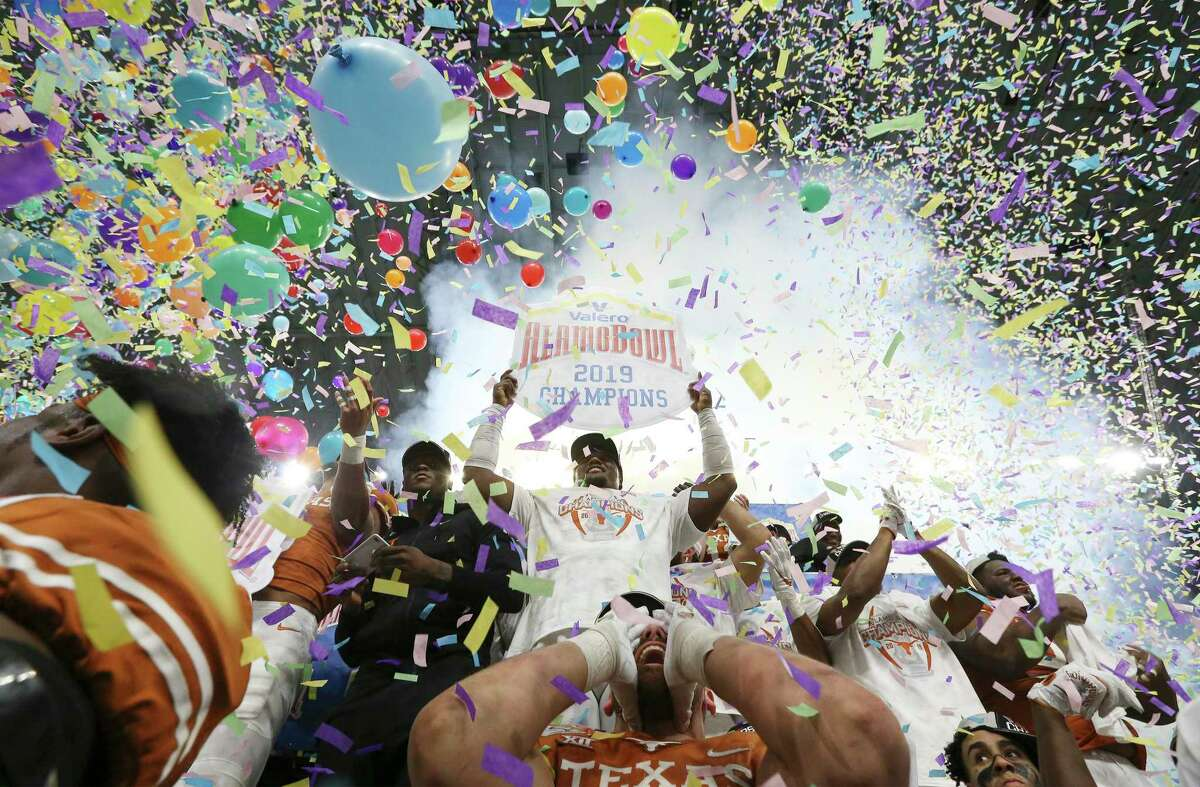 The Texas Longhorns celebrate with confetti and balloons as they defeat the Utah Utes at the 2019 Valero Alamo Bowl at the Alamodome on Tuesday, Dec. 31, 2019. The Longhorns defeated the Utes, 38-10, to win the 2019 Valero Alamo Bowl.