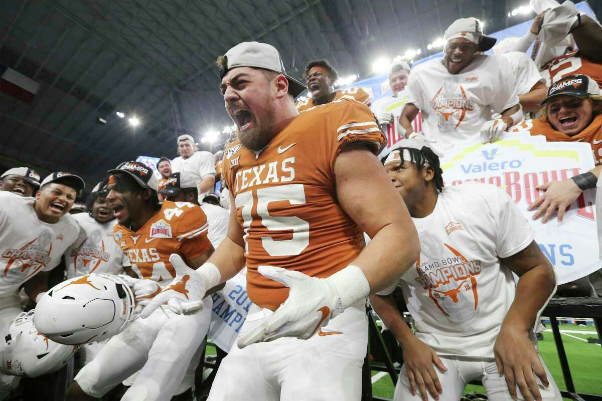Texas offensive lineman Junior Angilau (pictured middle) suffered a knee injury in the season opener.