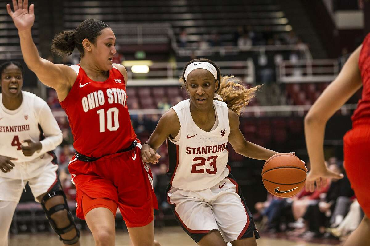 Stanford's Kiana Williams drives by Ohio State's Braxtin Miller during an NCAA women's basketball game on Sunday, Dec.15, 2019 in Palo Alto, Calif. (AP Photo/Tomas Ovalle)