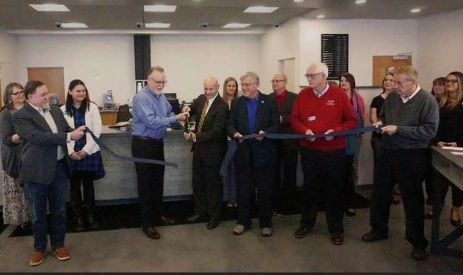 West Michigan Credit Union board members and employees participate in a ribbon cutting to celebrate the opening of the new location at 4795 220th Avenue in Reed City. The facility is now open and the former location in Vic's shopping center is closed. (Submitted photo)
