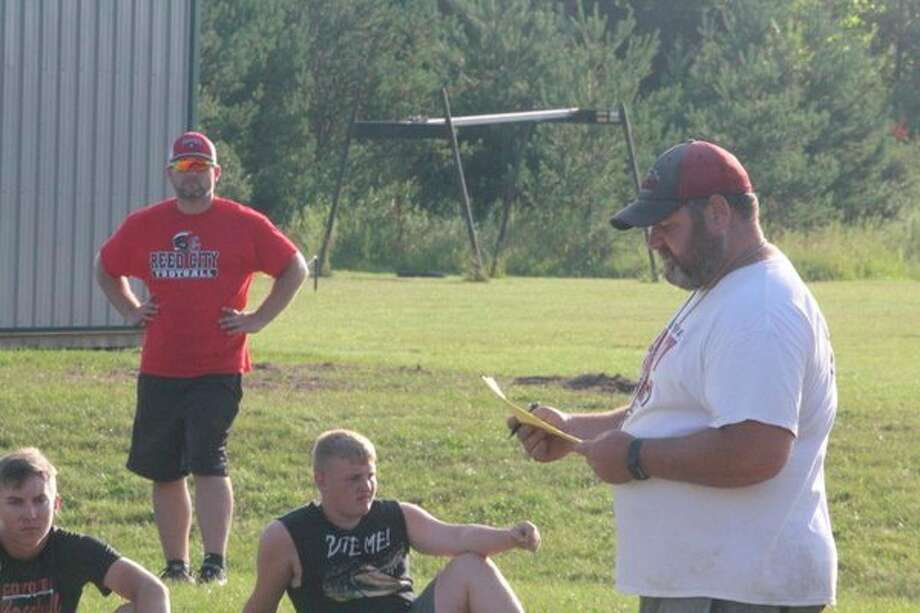 Scott Shankel (right) took over as Reed City football coach this season. (Herald Review file photo)