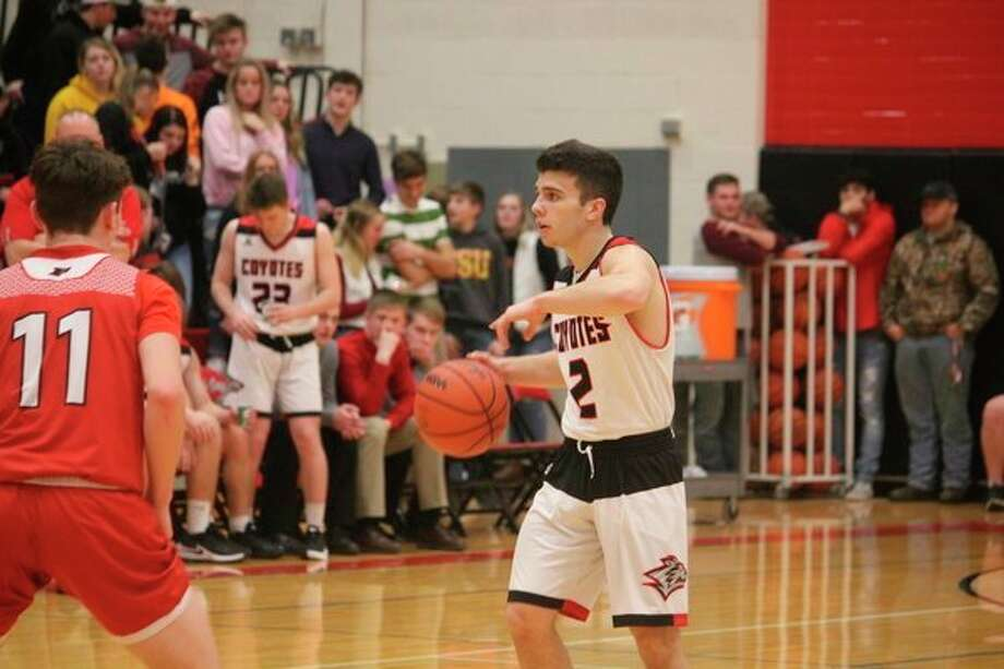 Zac Saez (right) directs the offense in recent action. (Herald Review photo/John Raffel)