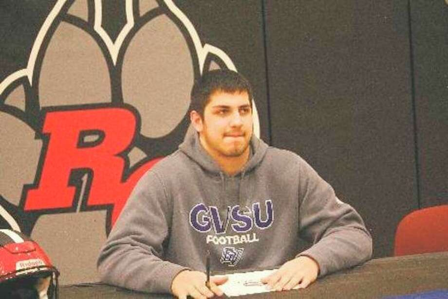 Anthony Pelton is pictured here on signing day when he formally committed last February to Grand Valley football. (Herald Review file photo)