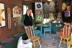 """Elsah resident Julie Connoyer, founder and owner of """"Peace Works: A Market with a Mission,"""" stands in a portion of the charitable gift shop that donates a percentage of shop earnings to such causethe Connoyer formerly owned a café and gift shop in Grafton called """"Peace of Quiche: A Café with a Cause,"""" which supported nonprofit causes and s. Now, she's taken this philosophy to Elsah at a new shop, """"Peace Works: A Market with a Mission."""""""