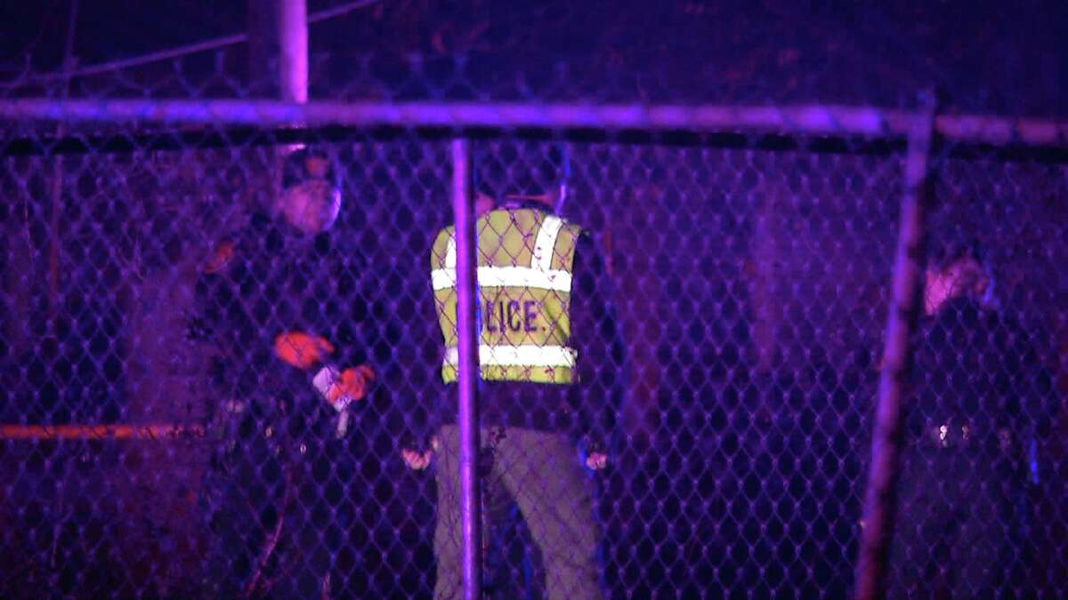A man and a 14-year-old girl were killed and two other children were injured after a truck that was driving at a high rate of speed hit them as they were backing out of a driveway in a neighborhood on the city's West Side.