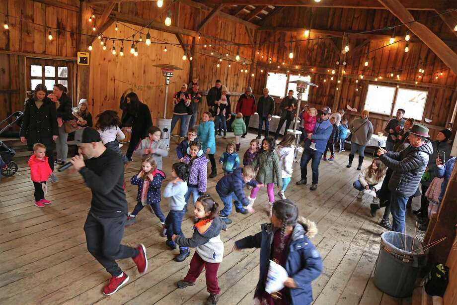 D.J. Marcell of Norwalk leads the kids in dance at the Noon Years Eve Party at Lachat Town Farm on Dec. 31, 2019 in Weston. Photo: Jarret Liotta / For Hearst Connecticut Media / Jarret Liotta / ©Jarret Liotta